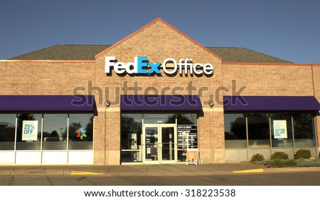 RIVER FALLS,WISCONSIN-SEPTEMBER19,2015: FedEx Office storefront. FedEx Corporation is headquartered in Memphis,Tennessee. - stock photo