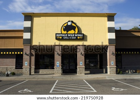 RIVER FALLS,WISCONSIN-SEPTEMBER 25,2014: The storefront of the local Buffalo Wild Wings restaurant.This restaurant chain was founded in Nineteen Eighty Two. - stock photo