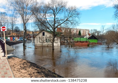 River flood inundated the city home - stock photo