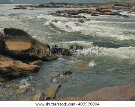 River flow through the rocks