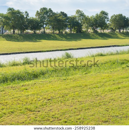 River flowes green meadow land under sunny day, Dong Shan River, Yilan City, Taiwan  - stock photo