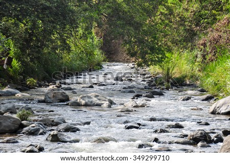 River flowing in Cali, Colombia. - stock photo