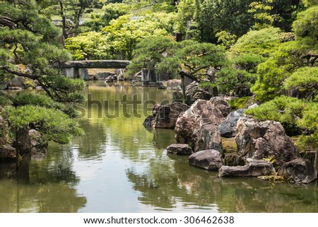 river flowing through Japanese zen garden - stock photo