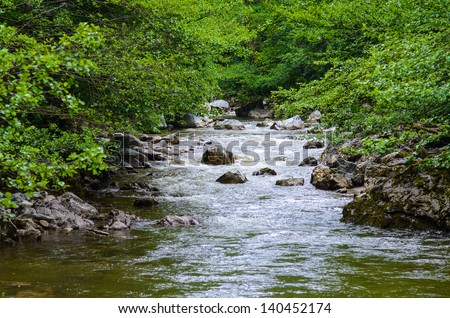River flowing through the mountain rocks