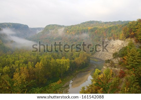 River flows between the banks of a beautiful autumn park in Upstate New York - stock photo