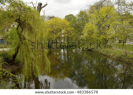 River in a city park in Hanover, Germany, in spring.