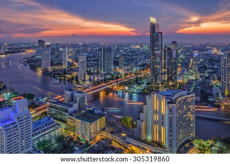 River in Bangkok city in night time with bird view - stock photo