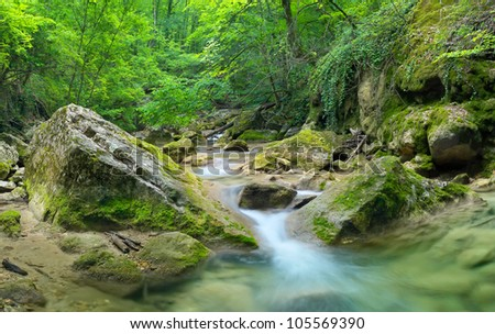 River in canyon and transparent water. Fresh summer composition - stock photo