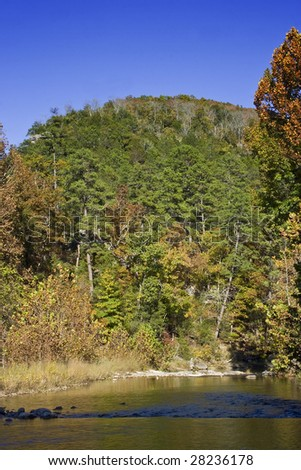 River in Ozark National Forest with mountain in background - stock photo