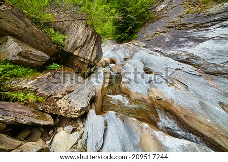 River in the Latoritei Valley in Romanian mountains - stock photo