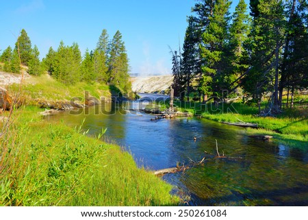 river in Upper Geyser basin of Yellowstone National Park, Wyoming - stock photo
