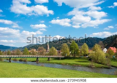 River Kinzig with church Saint Mauritius, Hausach, Black Forest, Baden-Wurttemberg, Germany, Europe - stock photo