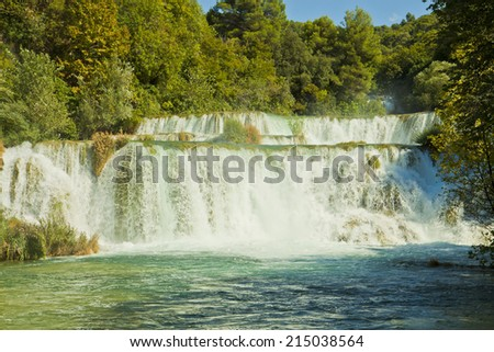 River Krka , great tourist attraction near Sibenik, forms three sets of waterfalls in an area 400 mt. in length and 100 mt. in width. - stock photo