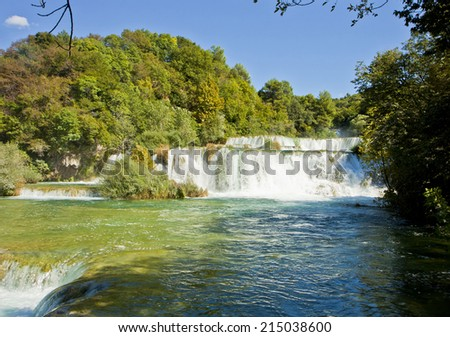 River Krka, great tourist attraction near Sibenik, forms 17 waterfalls in an area 400 mt. in length and 100 mt. in width - stock photo