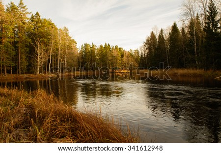 River landscape between autumn and winter  - stock photo