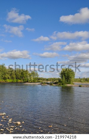 River landscape in the polar Urals. The pebbly shore of the North river Kokpela, Republic of Komi, Russia.