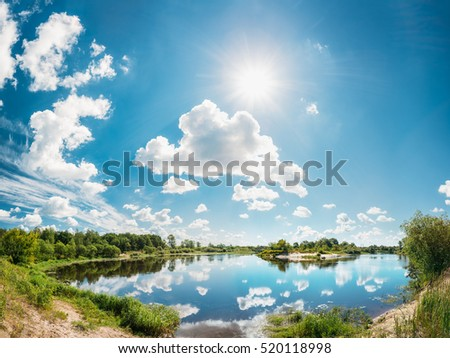 River Landscape Summer. Sunny Day. Nobody. Sun Shine In Blue Sky With White Clouds.