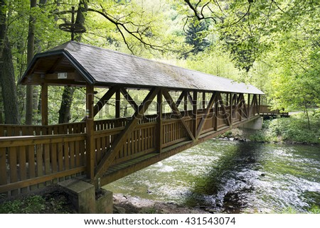 River Metuje by 'Nove mesto nad Metuji' in Czech Republic, covered bridge across the river by 'Peklo' village - stock photo