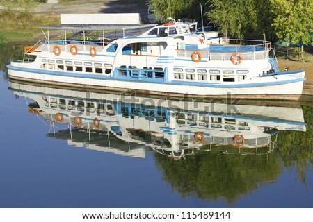 river motor ship in dock - stock photo