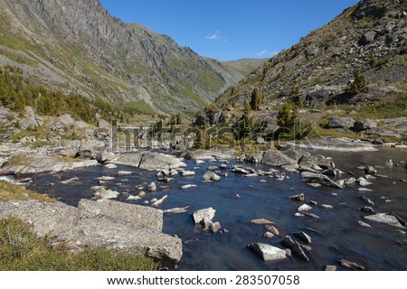 River, mountain, rocks - stock photo