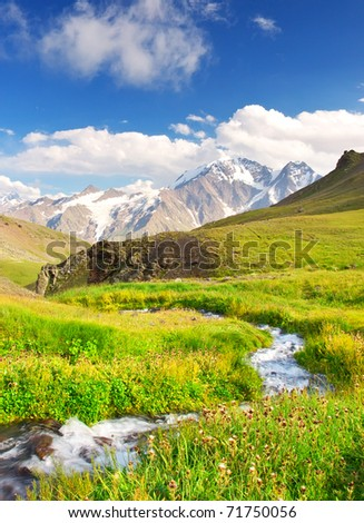 River on meadow amongst mountain valley. Natural composition - stock photo