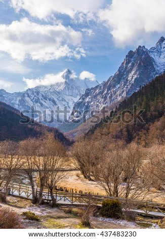 River on meadow amongst mountain valley. Natural composition Yading China - stock photo