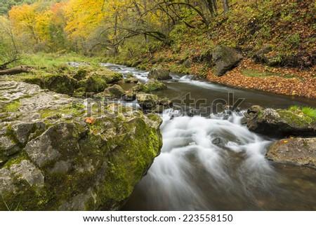 River Rapids In Autumn - stock photo