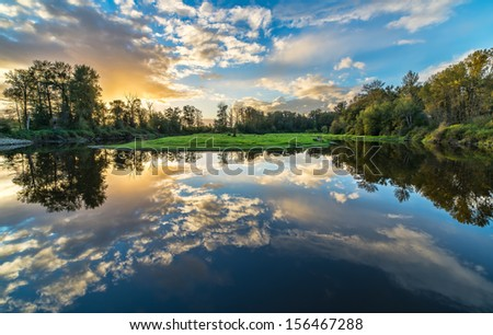River reflection of clouds over wide angle. - stock photo