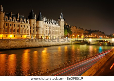 River Seine, palaces and townhouses in Paris night, capitol of France.