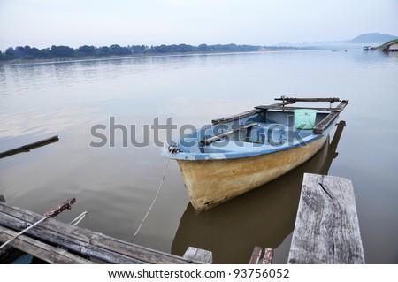 River Still Outdoor Nature Fiber Boat - stock photo
