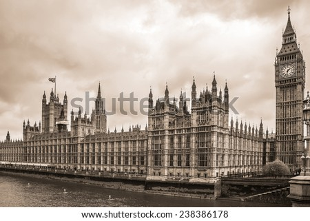 River Thames and Palace of Westminster (known as Houses of Parliament). Palace of Westminster located on bank of River Thames in City of Westminster, London. Vintage sepia photo.  - stock photo