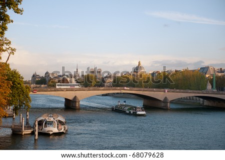 River the Seine with boats and a bridge in the afternoon