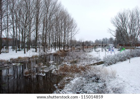 River through the snow, cold winter and forgotten children's slides