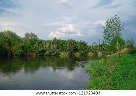 river,  trees and cloudy sky