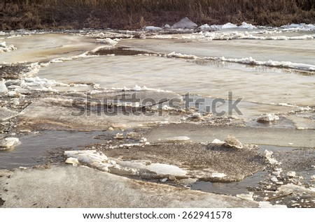 River valley with spring ice drifting at early morning before dawn. Zhizdra, Kaluzhskaya region, Russia.