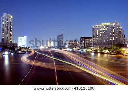 River view with the lights, boats and modern buildings at night, Bangkok, Thailand. - stock photo
