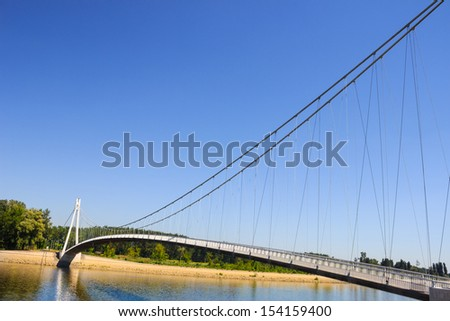 river walk bridge over the river near the city. abstract composition with space for your text. - stock photo