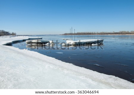 River With Broken Ice. ice hummocks on the river in spring. landscape close-up ice drift on the river in the spring on a sunny day - stock photo
