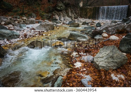River with colored stones and hot springs in Loutra Pozar in Northern Greece