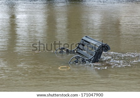 Riverside seat is submerged as the River Severn breaks its banks at Upton Upon Severn  - stock photo