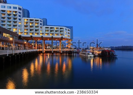 Riverside view at blue hour - stock photo