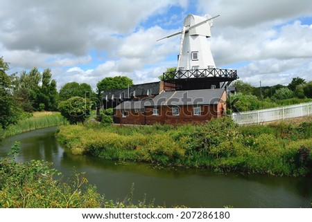 Riverside Windmill in the English countryside - stock photo