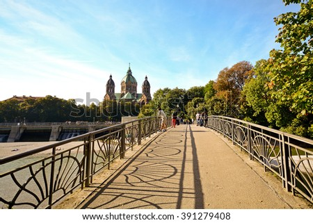 Riverside with bridge across the Isar River in Munich, Bavaria Germany Europe - stock photo