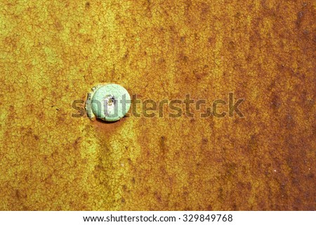 Rivet and rust spots on a steel plate in Lemmer, Netherlands. - stock photo