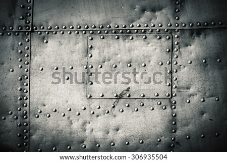 rivets on a metal plate - stock photo