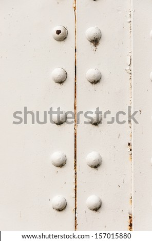 rivets on large corroding steel plates of a train and auto Bridge - stock photo