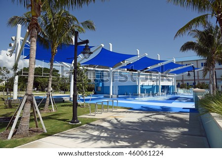 RIVIERA BEACH MARINA VILLAGE, FLORIDA - JULY 27: A beautiful blue sun shade and interactive fountain for children, on July 27, 2016, in Riviera Beach, Florida, at the new Marina Village complex. - stock photo