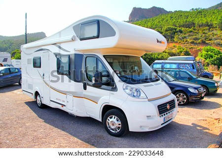 RIVIERA, FRANCE - AUGUST 3, 2014: White Fiat Ducato based motorhome Benimar Multijet 130 at the interurban road. - stock photo