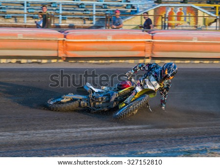 Rivne, Ukraine - 29 August 2015: Unknown rider falls at overcoming the track at the Open Cup Speedway to the day of the city Rivne - stock photo