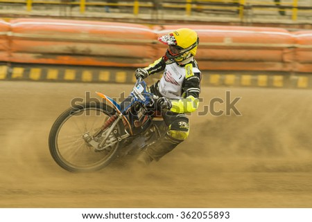 Rivne, Ukraine - 11 October 2015:  Rider  Vladimir Trofimov overcomes the track at the Open Cup Speedway to the day of the city Rivne